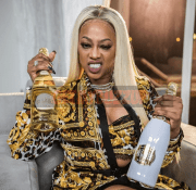 PHOTO 3_Trina with Belaire Gold and Belaire Luxe_-Optimized_result
