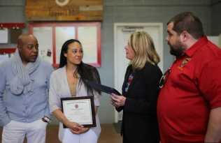 911 Director Destiny Davidson makes a presentation to Tanya and Chris Hayes-Optimized
