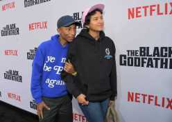 """LOS ANGELES, CALIFORNIA - JUNE 03: Pharrell Williams and Helen Lasichanh attend Netflix world premiere of """"THE BLACK GODFATHER at the Paramount Theater on June 03, 2019 in Los Angeles, California. (Photo by Charley Gallay/Getty Images for Netflix)"""
