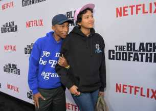 "LOS ANGELES, CALIFORNIA - JUNE 03: Pharrell Williams and Helen Lasichanh attend Netflix world premiere of ""THE BLACK GODFATHER at the Paramount Theater on June 03, 2019 in Los Angeles, California. (Photo by Charley Gallay/Getty Images for Netflix)"