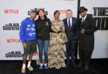 """LOS ANGELES, CALIFORNIA - JUNE 03: Pharrell Williams, Helen Lasichanh, Nicole Avant, Netflix Chief Content Officer Ted Sarandos and Jimmy Jam attend Netflix world premiere of """"THE BLACK GODFATHER at the Paramount Theater on June 03, 2019 in Los Angeles, California. (Photo by Charley Gallay/Getty Images for Netflix)"""