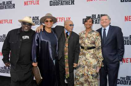 "LOS ANGELES, CALIFORNIA - JUNE 03: (L-R) Cedric the Entertainer, Queen Latifah, Quincy Jones, Nicole Avant and Netflix Chief Content Officer Ted Sarandos attend Netflix world premiere of ""THE BLACK GODFATHER at the Paramount Theater on June 03, 2019 in Los Angeles, California. (Photo by Charley Gallay/Getty Images for Netflix)"