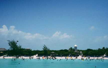 Cruise-goers enjoy a private beach at Half Moon Cay in The Bahamas (Credit: Sara Newcombe)