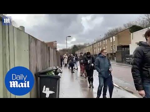 London in Tier 4: Massive queue for butcher winds around street in capital