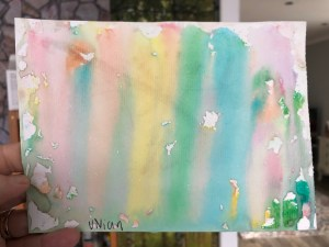 Multicolored watercolor painting with a washed streaky effect running down the page.