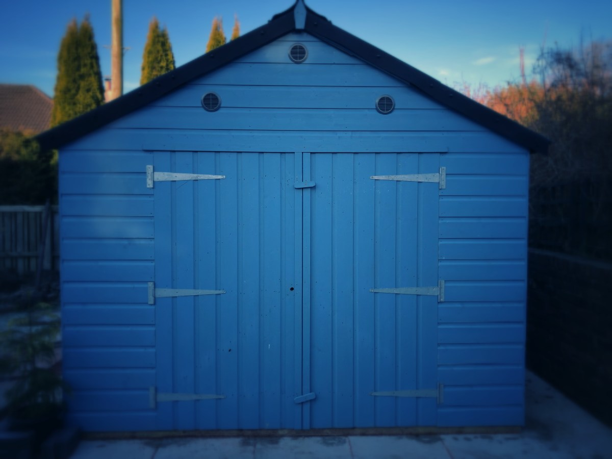 Shed with two large doors and three vents above the doors.