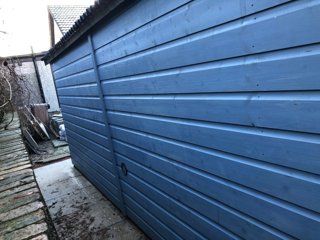 A single vent on the side of the shed.