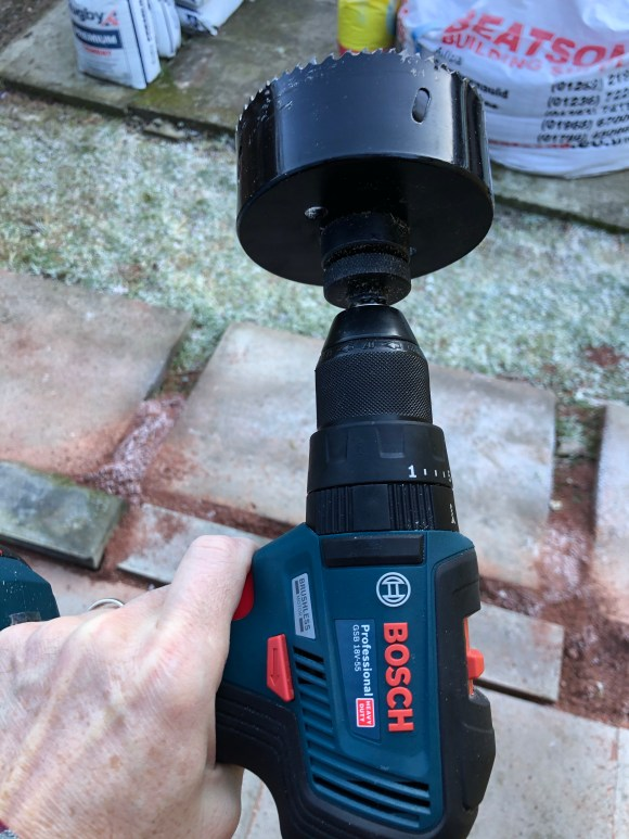 Hole saw attached to a electric drill.