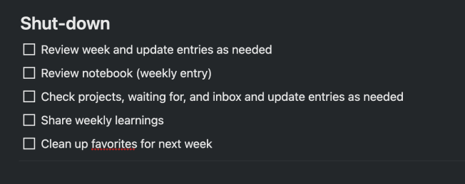 Weekly shut-down checklist in Notion.