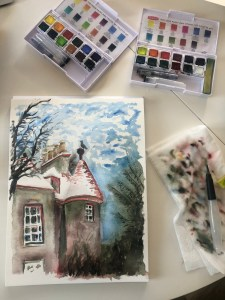 Watercolor painting on table with painting sets.