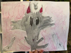Kids illustration of a wolf with other wolves howling around it.