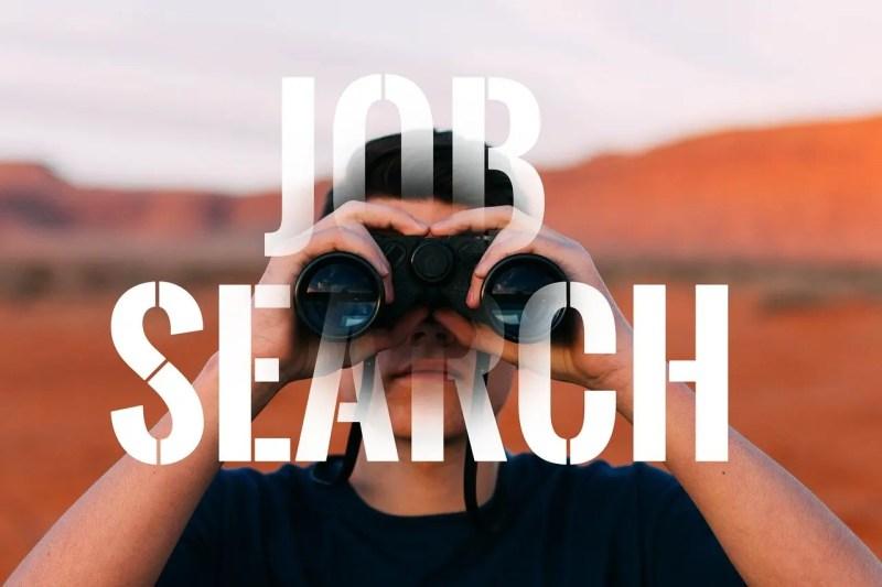 man with binoculars look for a job