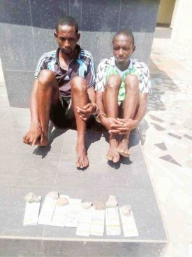 Two suspected armed robbers nabbed with fake $800,000 along Lokoja-Abuja highway