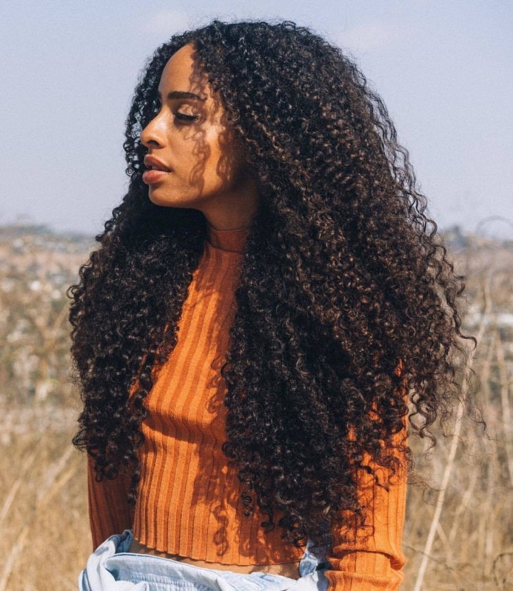 Voluminous curly hair with sew-in weave hair