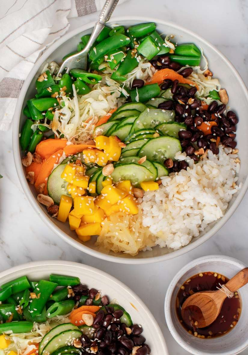Refreshing rice bowl healthy summer meals with basil, mango, and a light sauce add a punch of flavor to a hefty serving of crisp veggies.