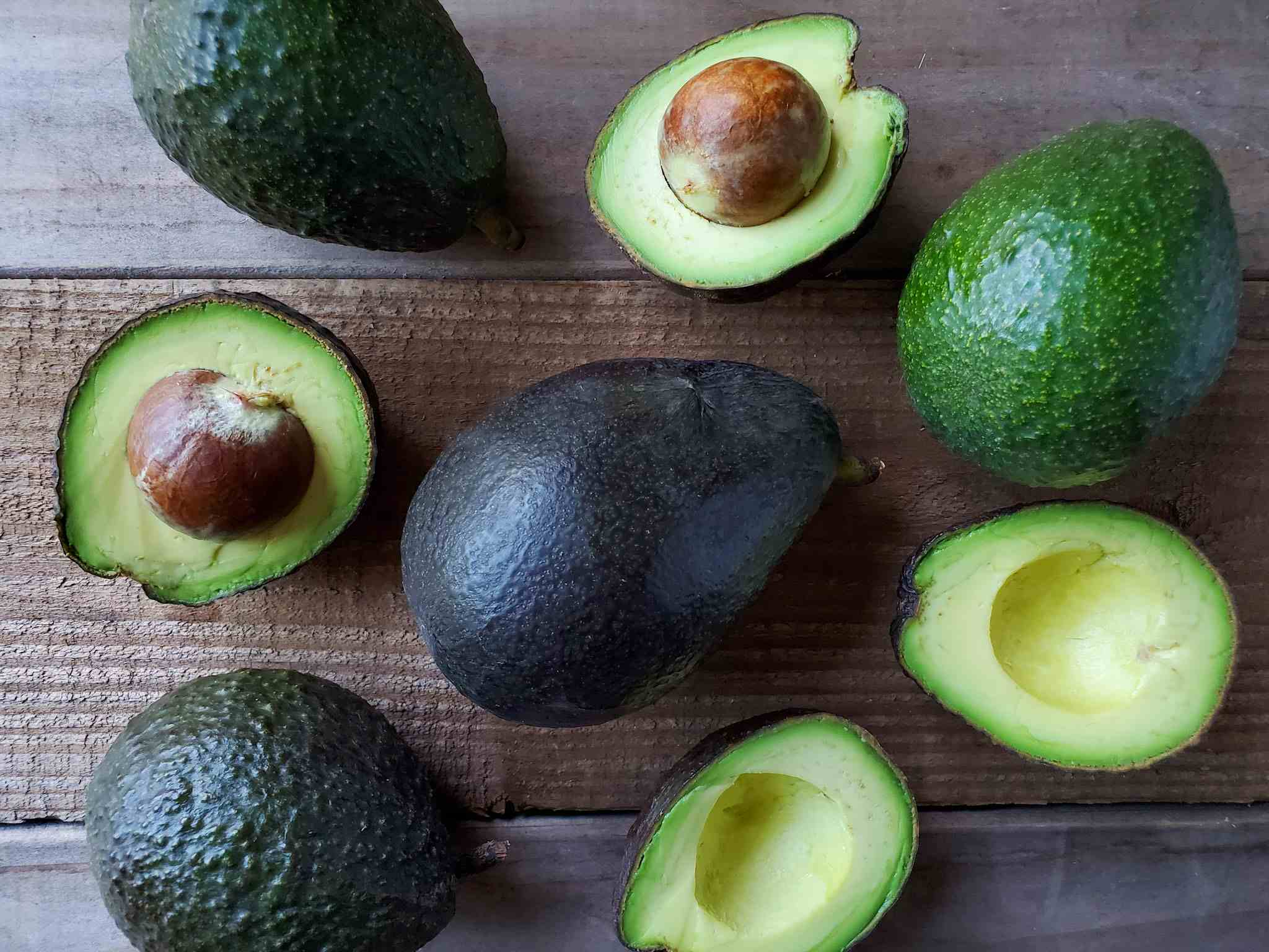 Avocado is a bright green fruit with a large pit and dark leathery skin. They're also known as alligator pears or butter fruit.