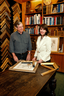 The frame can be almost as important as the art. Here, Pamela and Bill Hartman select moldings for antique prints from the collection at his gallery on Palm Avenue.