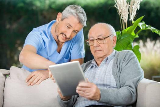 Caretaker_Elder_on_Tablet Rural Hospital Closures: How Telemedicine Could Provide Relief
