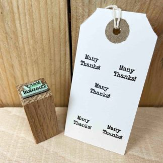 rubber stamp that reads 'many thanks!' in a typewriter font