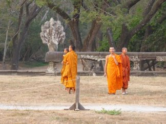 These super young monks had just run away from a monkey screaming, it was hilarious.