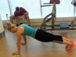 Start in a plank for spyder pushups.