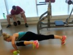 Drop into a pushup. While doing so, draw one knee up to the outside of your elbow.