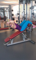 Contract and sit up, aiming to pull your chin up towards the ceiling. Now stay here for a 1-2 count, slowly lower back. Only doing 15 reps seems easy but...give it a try. I am telling you, you will feel this.
