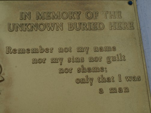 A plaque located at the Point Lookout cemetery entreats visitors to leave their judgments at the gate and approach the burial site with unblemished sympathy. Wikimedia Commons.