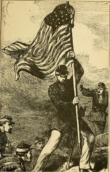 A Union color bearer with his flag. Photo via Wikimedia Commons.