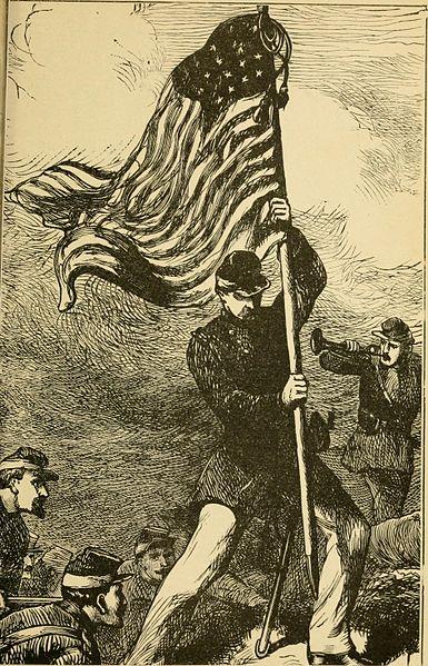 A Union color bearer with his flag. Photo via Wikimedia Commons.