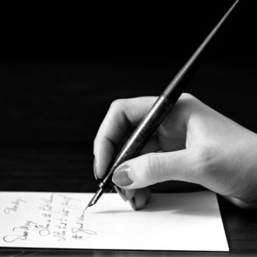 Image of hand writing a letter for article about how to write your will