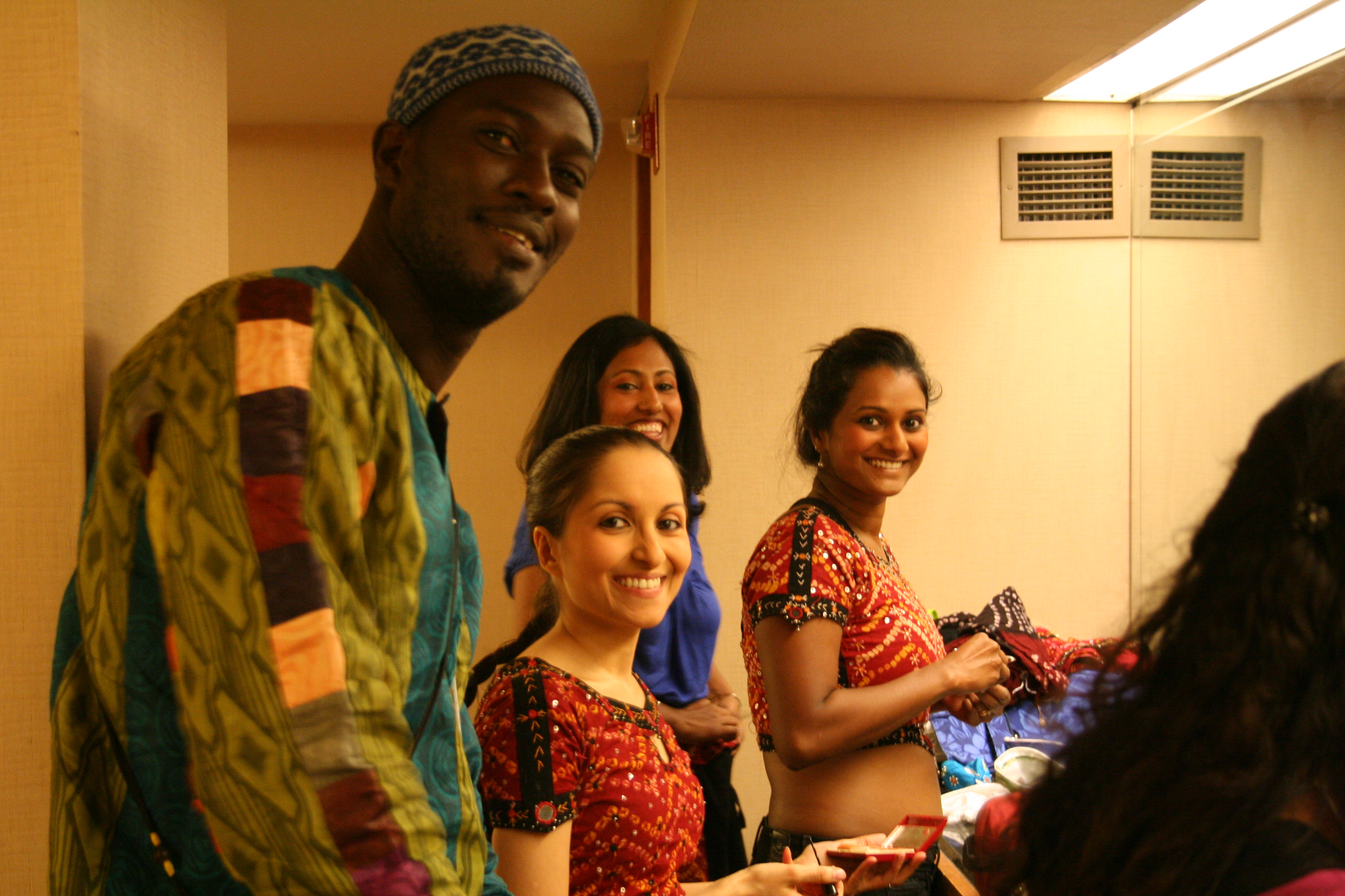 Moustapha with the Bollywood & Bhangra Indian Folk Dancers at Primary Source fund raiser.