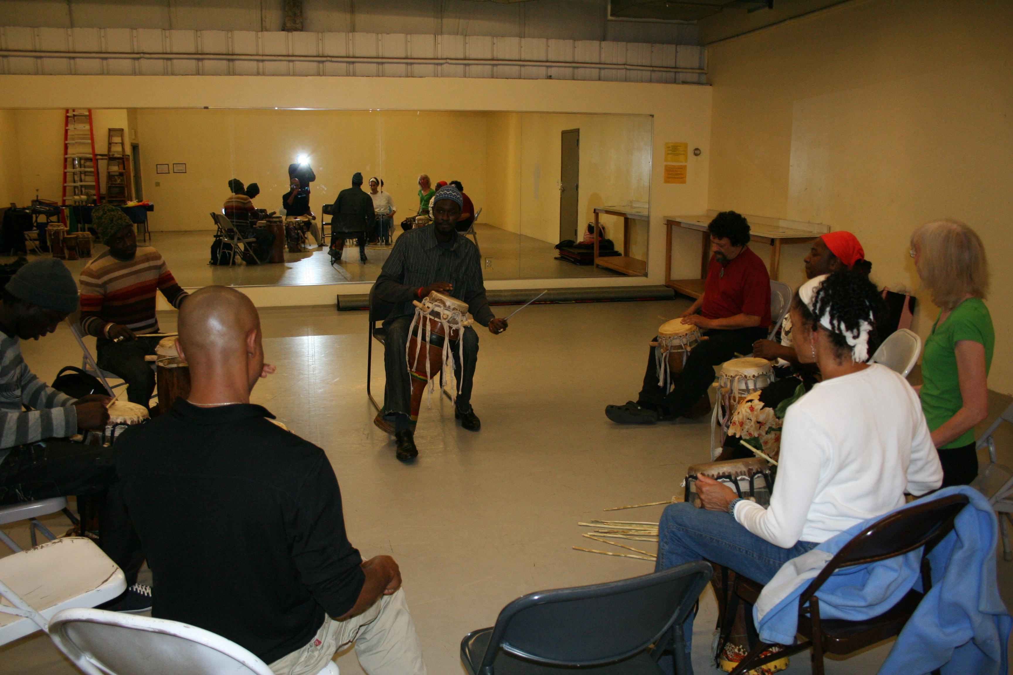 Moustaph Faye teaching drum class.