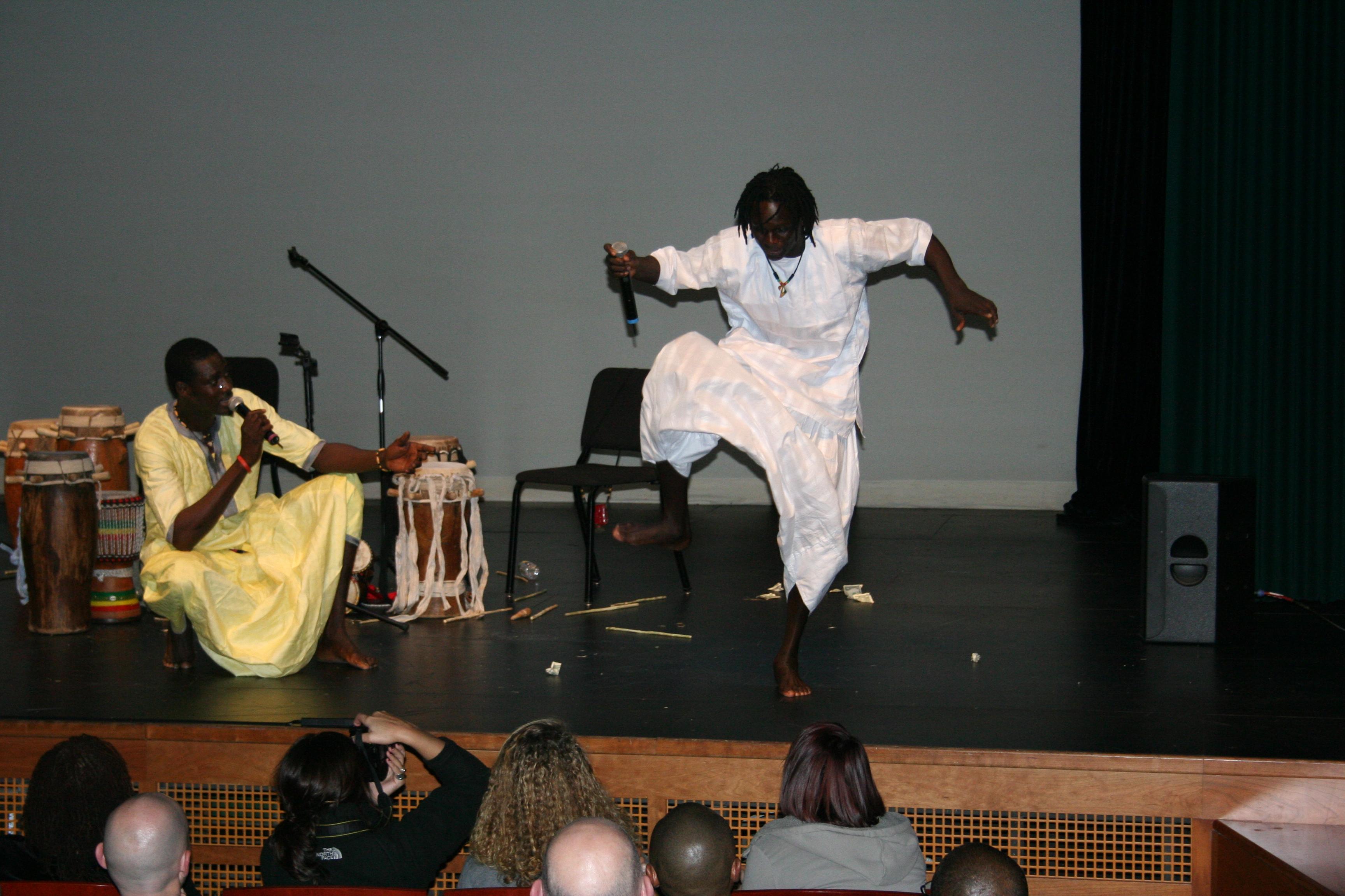 Malick dances as Moustapha raps Tassu.