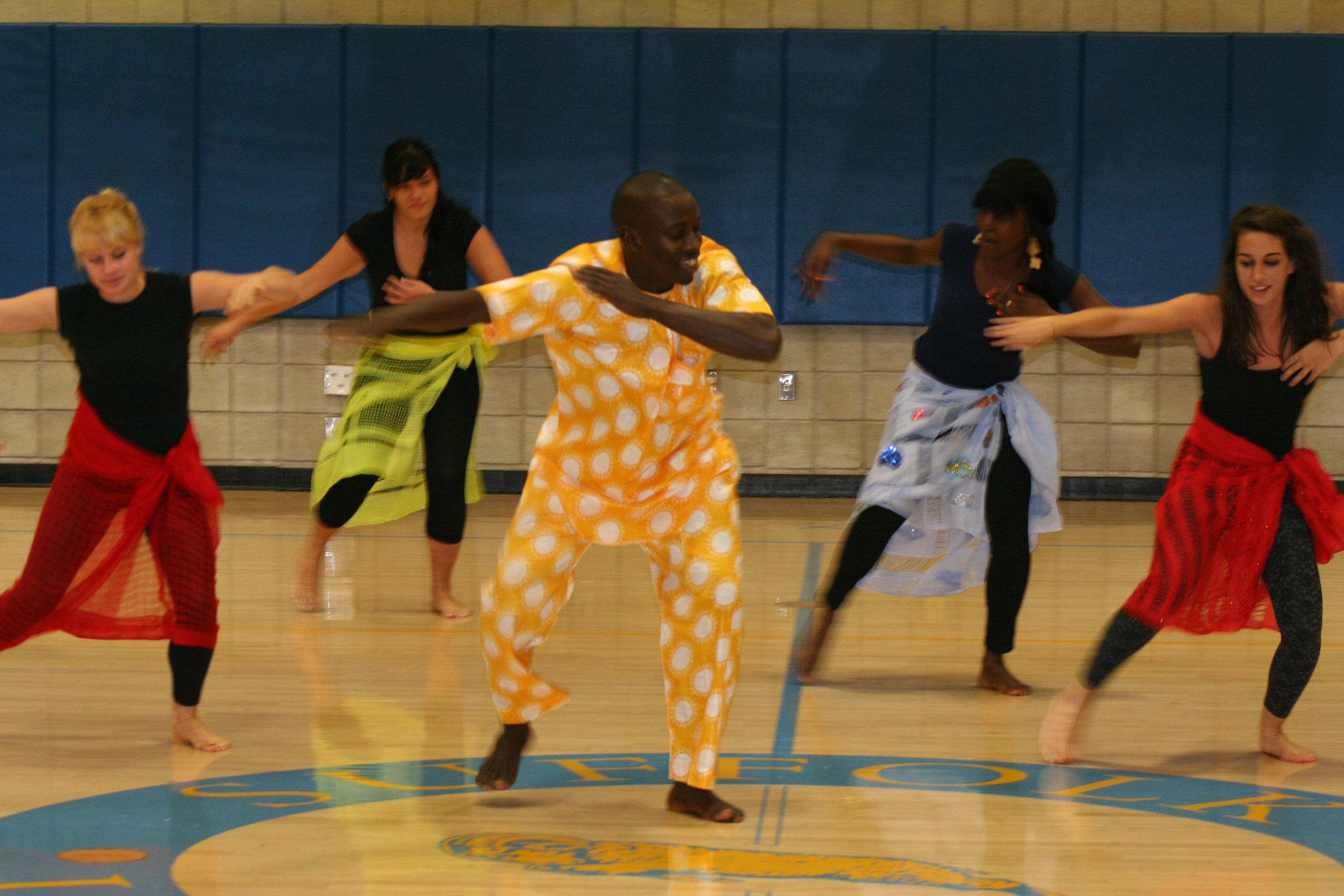 Aziz leads dance students in choreography.