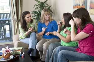 Learning Young Living Products at a home gathering