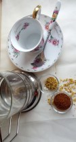 What you need: 1)A French press 2)A teacup 3)Rooibos tea leaves 4)Dried Osmanthus flowers