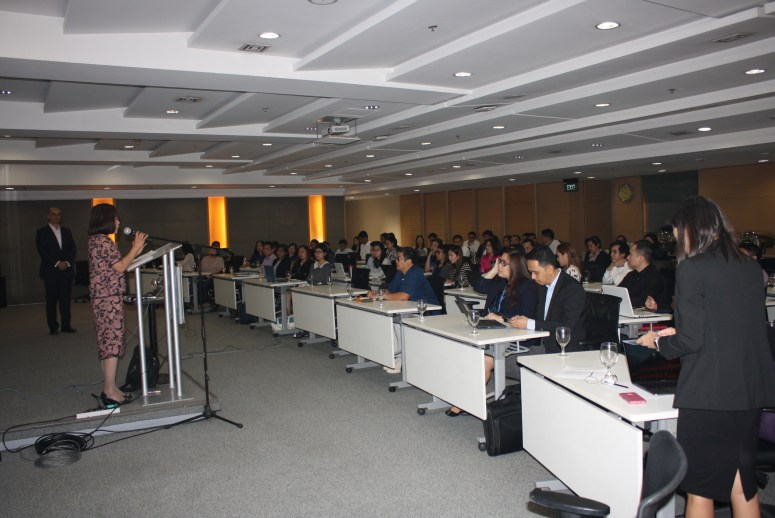 Tariq Dennison being introduced to an audience of over 60 of the country's top bond traders by Philippine national treasurer Rosalia De Leon.