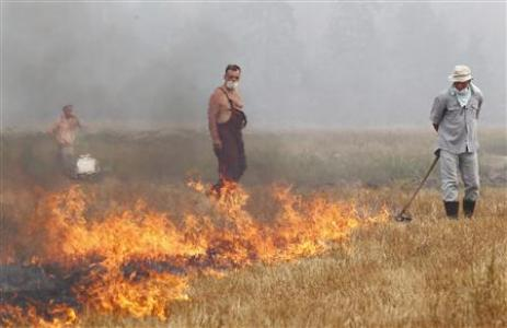 Accusations Of Denial As Fires And Smoke Kill In Russia Photo: Mikhail Voskresensky