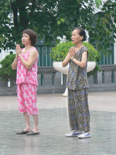 Early morning prayer time to Lý Thái Tổ (Ly Thai To), Hanoi, Vietnam.