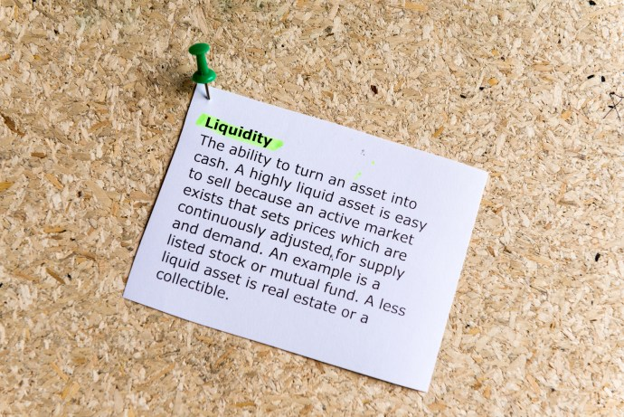 liquidity word typed on a paper and pinned to a cork notice board