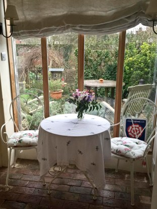 Tiny, little conservatory overlooks the private garden, but we can't get the door open.