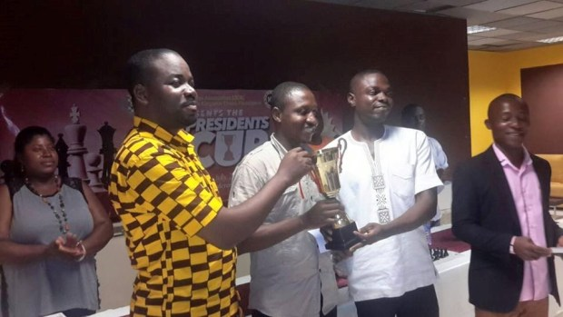 Emmanuel Ochuko, (middle) receiving trophy from chess officials