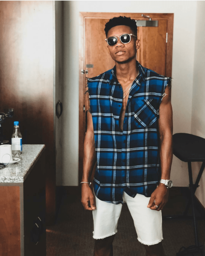 Kidi serving simple but style-ish look in shorts and sleeveless