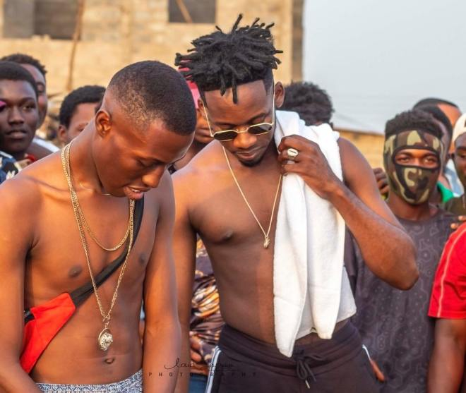 J.Derobie and Mr Eazi in Poverty music video