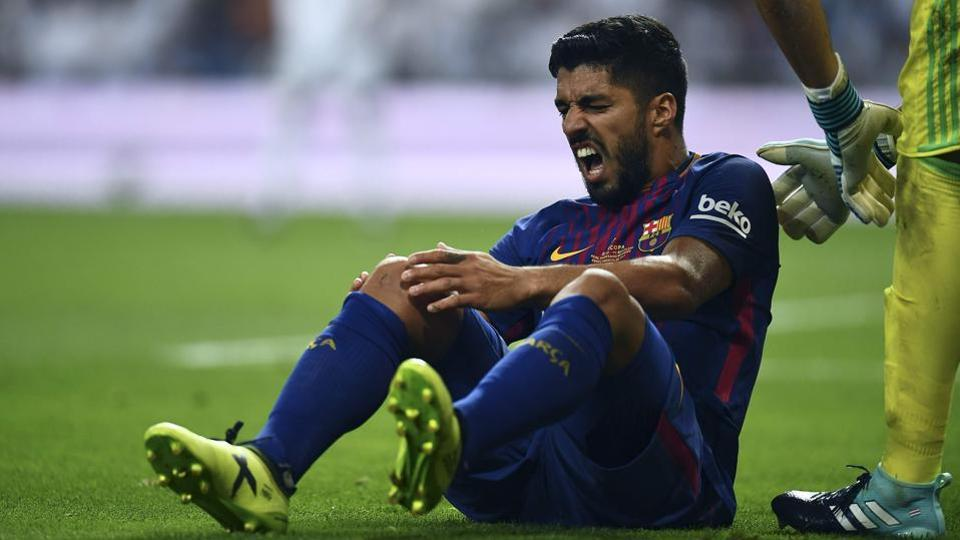 Another blow for Barcelona as Luis Suarez suffers knee injury