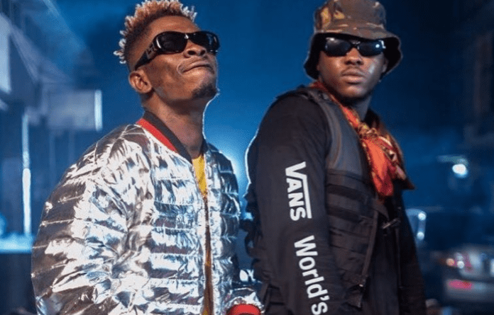 "AMG record rapper Medikal has purchased a brand new phone for the Shatta Movement boss, Shatta Wale, to ease their private conversations. According to Shatta Wale, who shared the photo on his Instagram page, Medikal gifted him the phone because ""he says my line is always busy."" Shatta Wale, who shared the photo on social media, had this caption: ""So @amgmedikal just bought me 11pro iphone just to talk to me cuz he says my line is always busy ….AMG fans pls thank your Boss for me 🙏🏽 hmmmm this my superstar wont kill me ! Thnx bro 👍🏾👑❤️‬."" Recently, Shatta Wale was spotted on his knees begging Medikal's girlfriend Fella Makafui to forgive the rapper for wronging her in a video that went viral. In the video, Shatta Wale was heard saying ""I will resolve everything and make sure they come back together,"" as he hugged Fella Makafui."