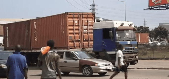 Danger looms on the roads - Unlatched Cargo Trucks.