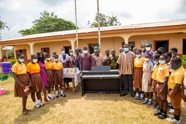 Deputy Minister presents education materials, piano to schools in Assin South