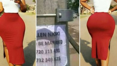Photo of Beautiful lady hangs posters in the streets, looking for a man to marry her